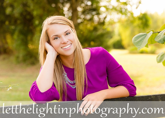 High School Senior Portraits of girl leaning on a fence by local Northern Virginia Photographer
