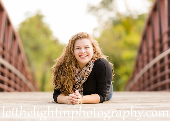 Girl sitting on the bridge in Warrenton Virginia posing for her Senior Portraits.