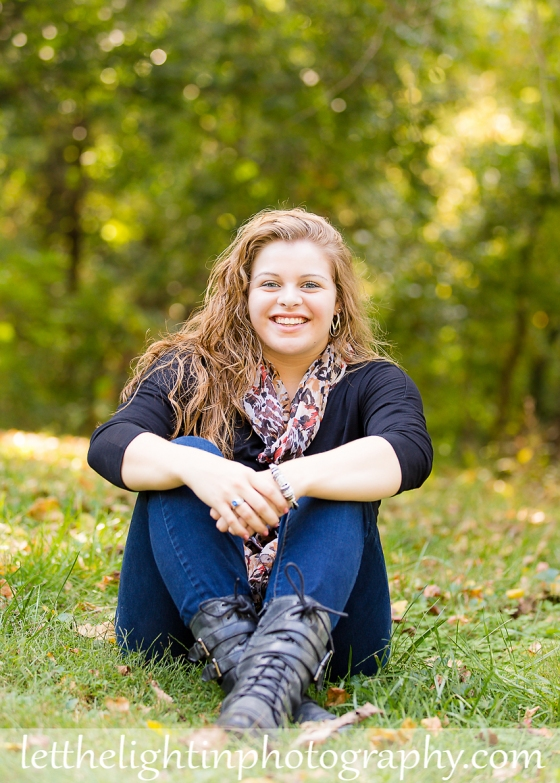 High School girl sitting in the grass taken by local Warrenton Virginia Photographer