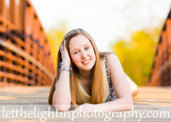 High School Senior Posing on a bridge at the Warrenton Greenway