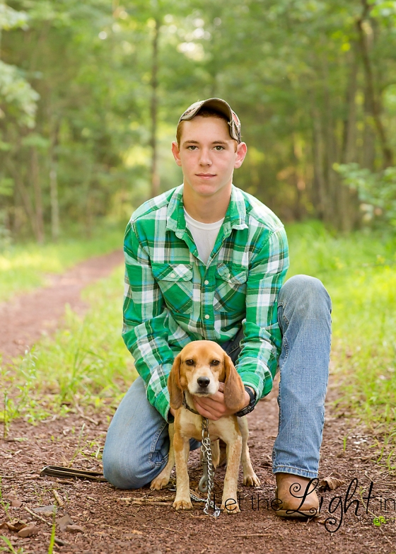 High School Senior posing with his hunting dog for Portraits by local photographer near Bristow VA