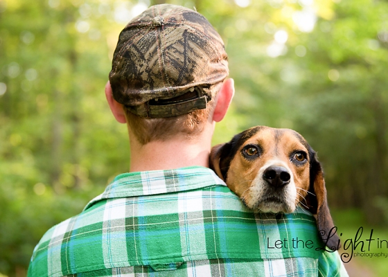 Senior with his hunting dog looking over his shoulder.