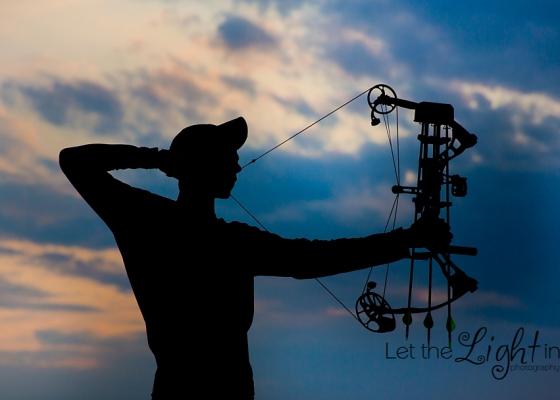 Senior shooting his hunting bow