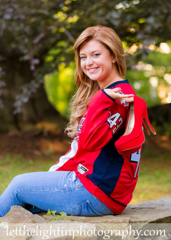 High School Senior Girl posing for pictures in a Washington Capitals Jersey