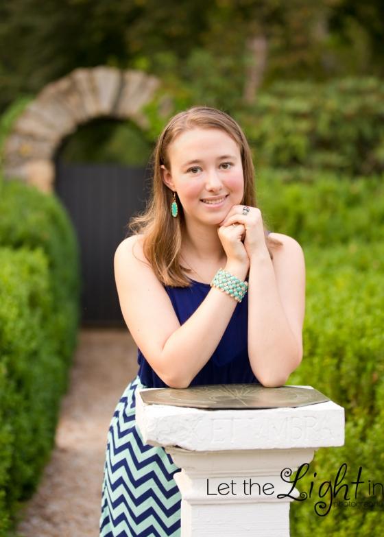 Girl leaning on pestal for Senior Portrait Photographer