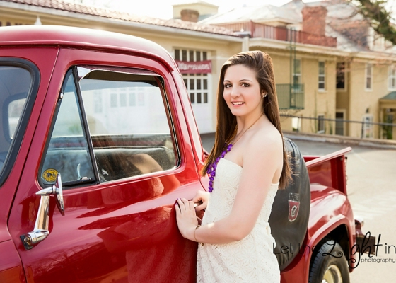 Girl standing near vintage truck in old town Warrenton Va