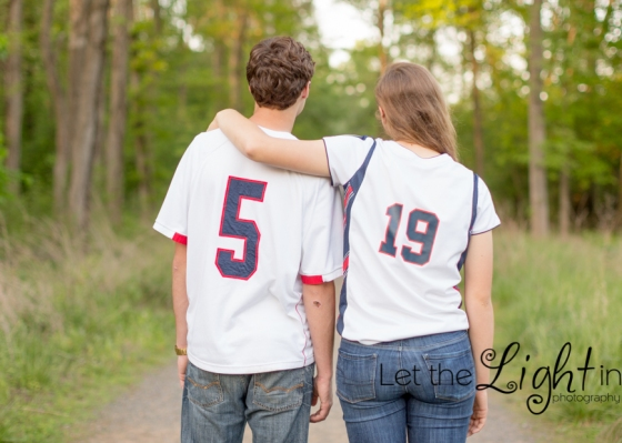Siblings pose back to camera to show jersey numbers